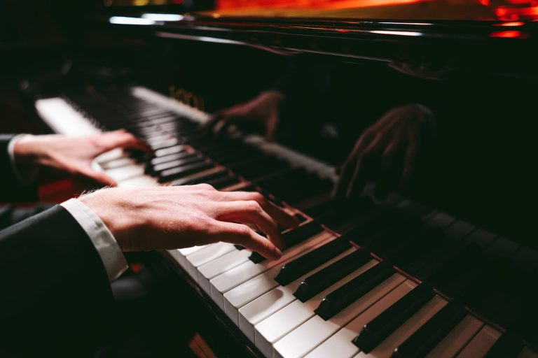 Image of one Cornwalls Best Wedding Pianists hands while playing wedding ceremony repertoire on a Fazioli Piano.