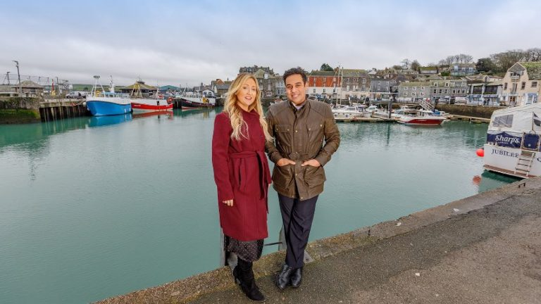 "Image of Michelin Star chef Paul Ainsworth and wife Emma Ainsworth on Padstow Harbour. Elastic Lounge provided Paul with a bespoke Cornwall Jazz Band on 8th February 2020 for this relaunch event at the well known Cornwall restaurant ""Caffè Rojano by Paul Ainsworth"" in Padstow. Paul hired Elastic Lounge to create bespoke New York themed Jazz Band for his relaunch event which would match the New York inspired refurbishment and restyling of the restaurant. Elastic Lounge created a bespoke Jazz Band using the best local jazz musicians in Cornwall. The Cornwall Jazz Quartet contained a well known line up including the best Cornwall Jazz Drummer, Pianist, Double Bassist and Trumpet player who played a mixture of well known jazz songs for guest arrivals and throughout the evening. Following the event Paul left the following review on Elastic Lounge's Google local business listing: ""Elastic Lounge brought a fantastic band to our launch party at Caffè Rojano in Padstow. They were incredibly easy to work with and gave a great performance which really got our party going. We'd definitely hire them again""."